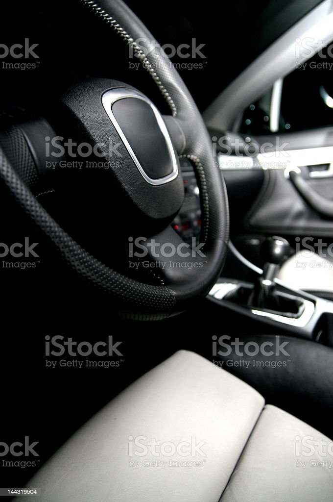 Driver view of black and white car interior royalty-free stock photo