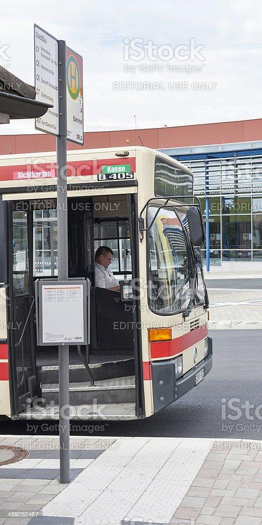 Driver waiting at German bus stop royalty-free stock photo