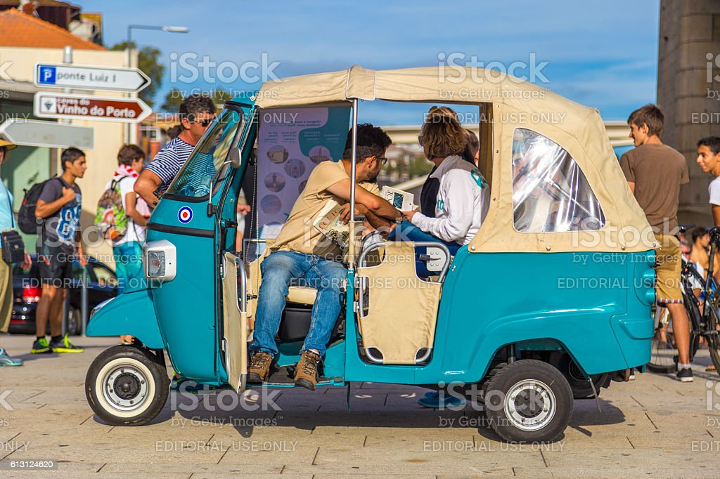 Driver waits for two tourists to drive on tricycle stock photo