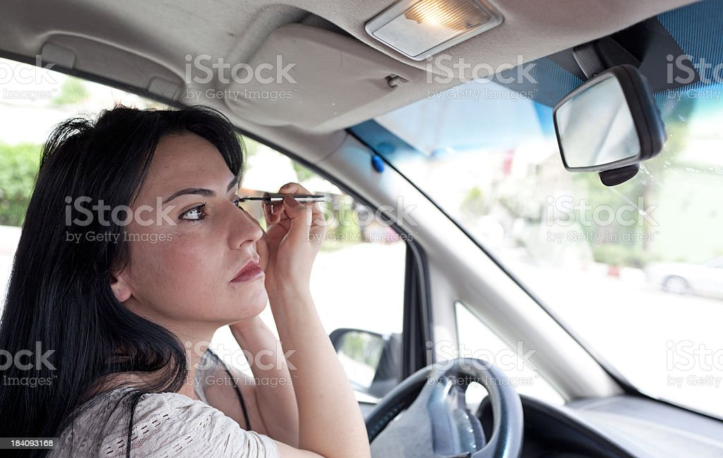 Driver Woman Make-up in car at traffic jam stock photo