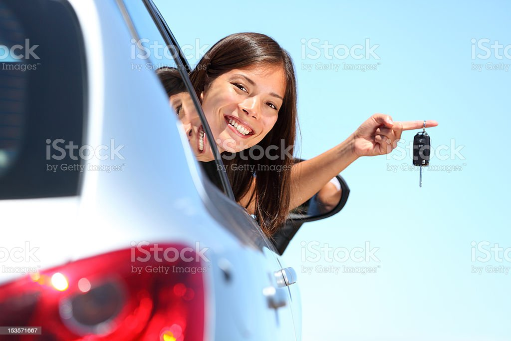 Driver woman showing new car keys stock photo