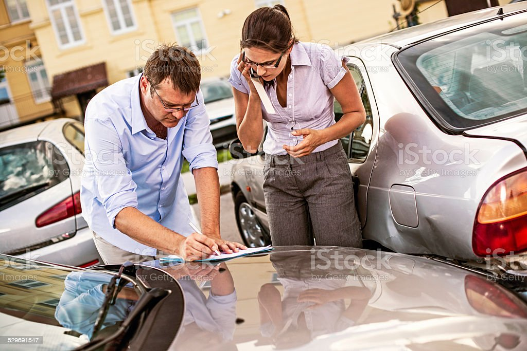 Drivers Fill Out an Accident Report stock photo