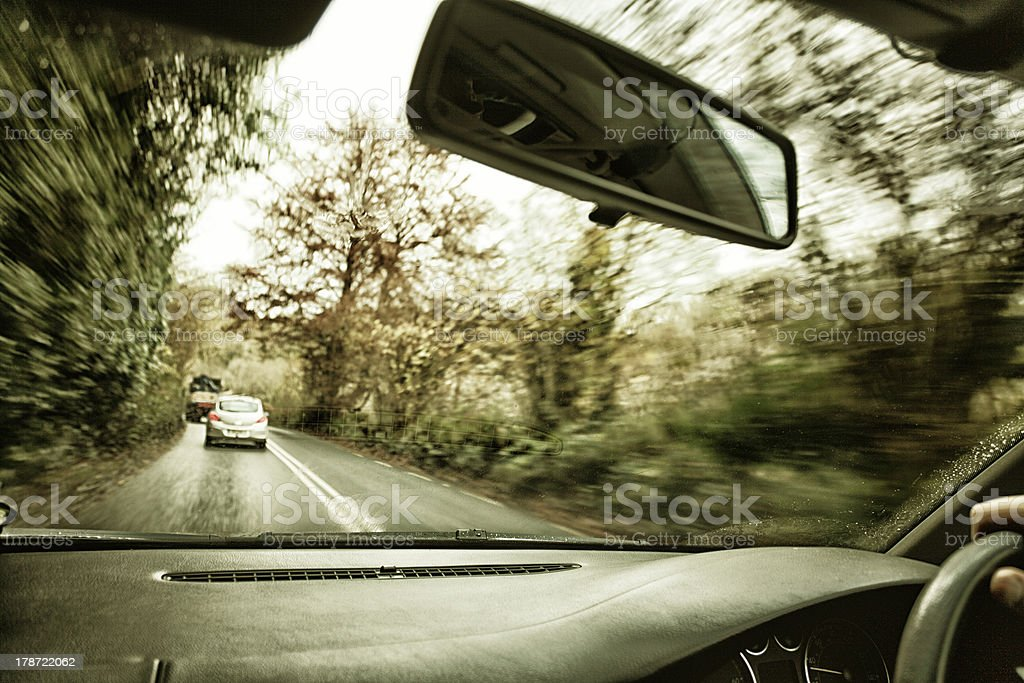 Driver's hand on a steering wheel of  car royalty-free stock photo