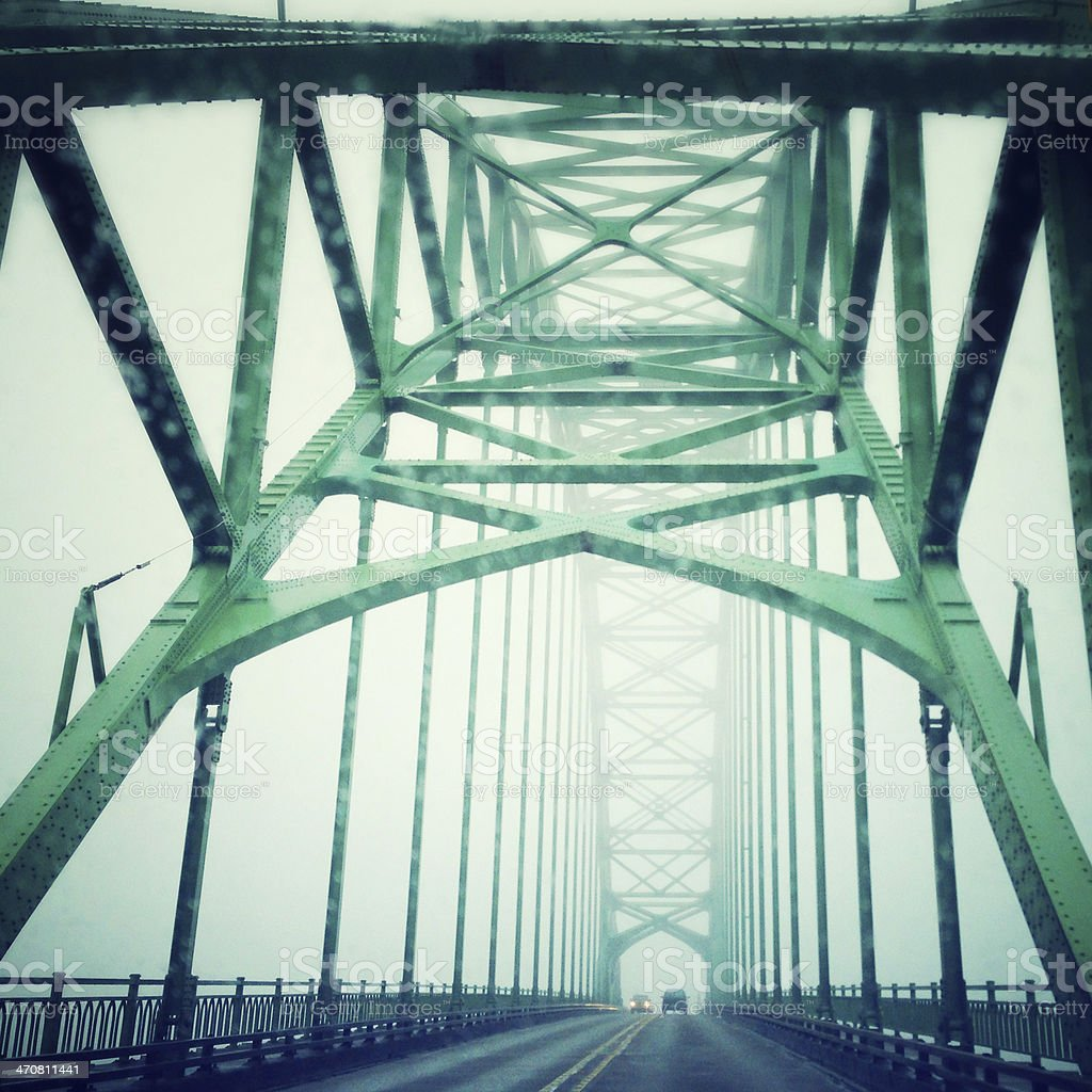 Driver's perspective while crossing a bridge in fog royalty-free stock photo