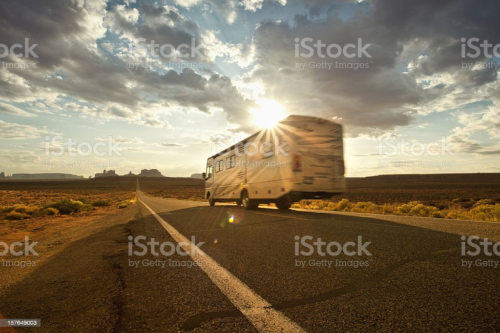 RV drives down the highway royalty-free stock photo