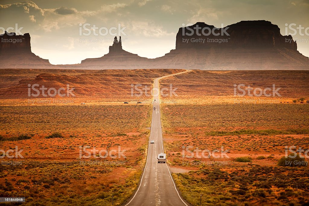 RV drives down the highway stock photo