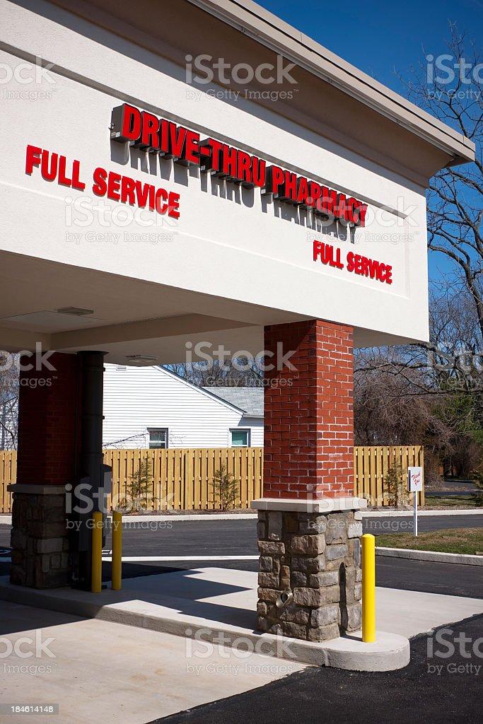 A drive-through pharmacy with brick pillars stock photo