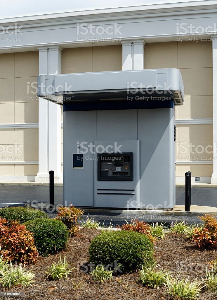 Drive-up ATM Machine Beside A Bank stock photo