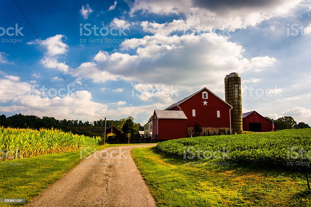 Driveway and red barn in rural York County, Pennsylvania. stock photo