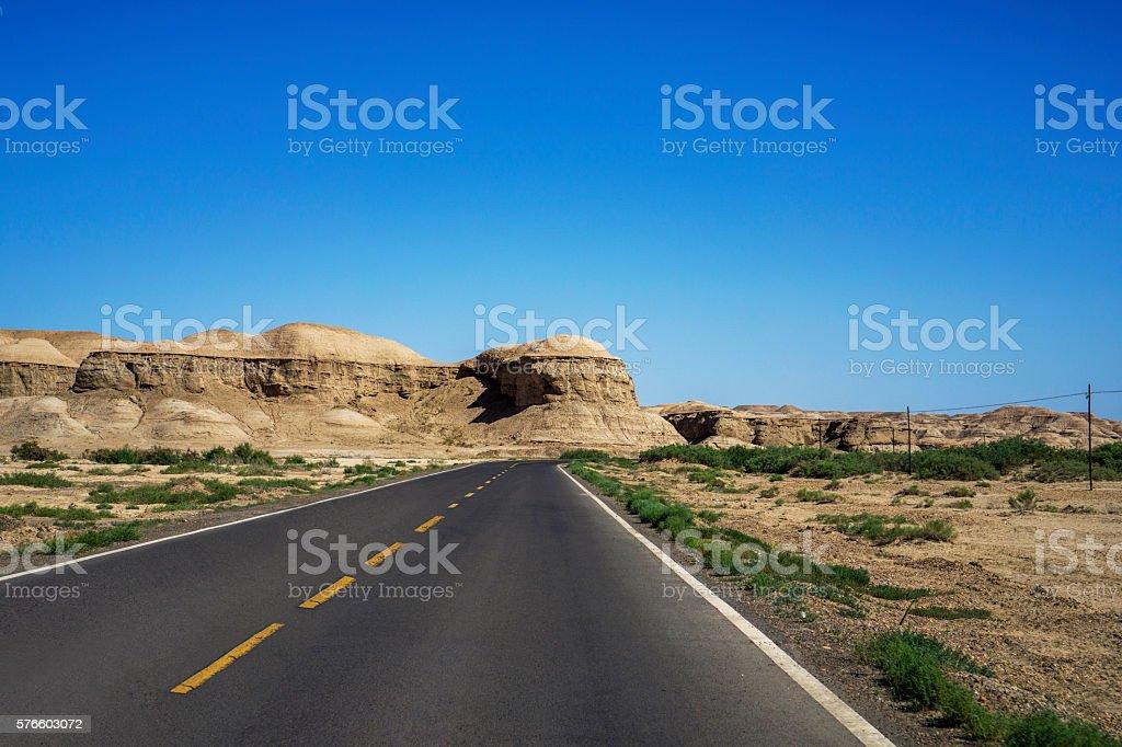 driveway through gobi and mountain stock photo