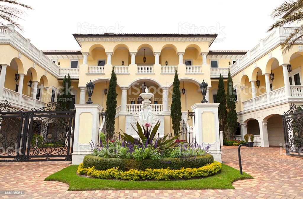 Driveway to luxury two story yellow and White House stock photo