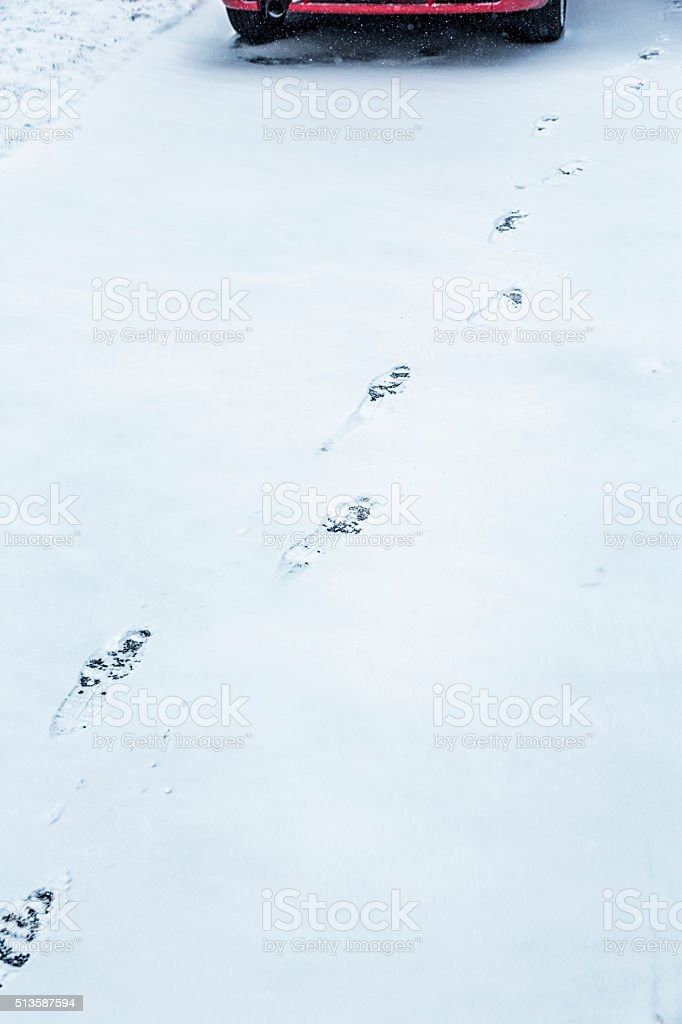 Driveway Winter Snow Car Driver Footprints stock photo