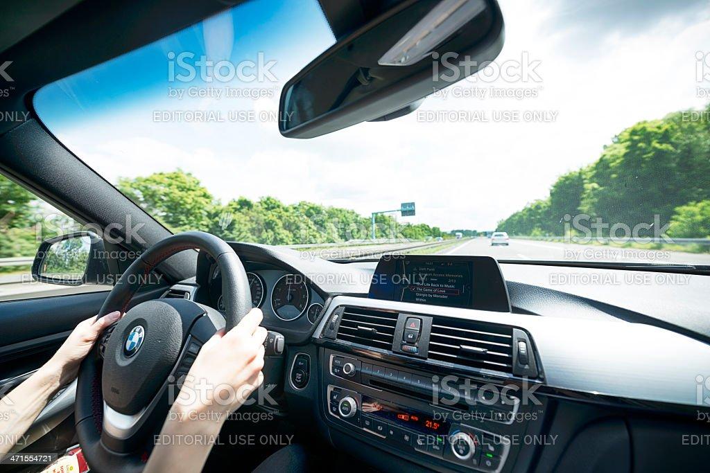 Driving a BMW 320d 2013 (E90) stock photo