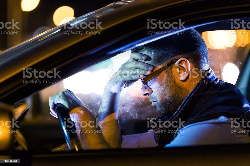 Driving a car at night  fatigue stock photo