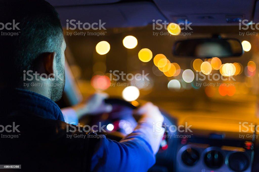 Driving a car at night stock photo