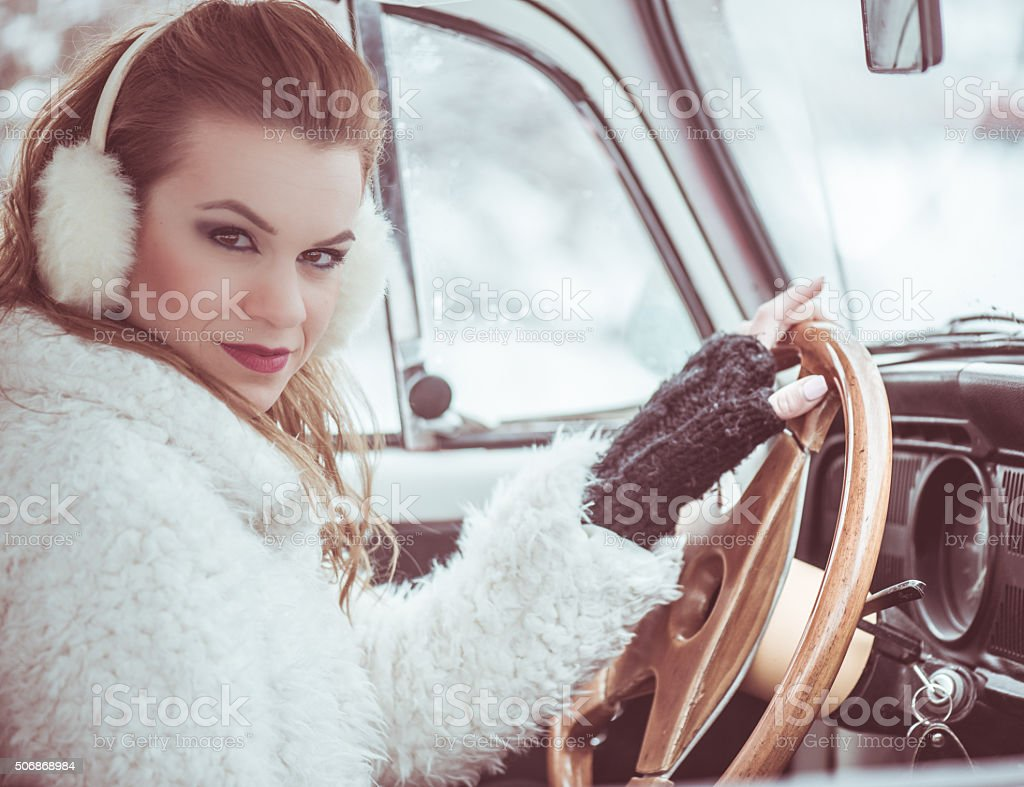 Driving a car at wintertime stock photo