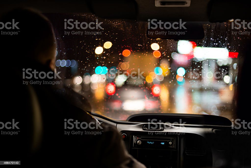 Driving a car in night town scenery. stock photo