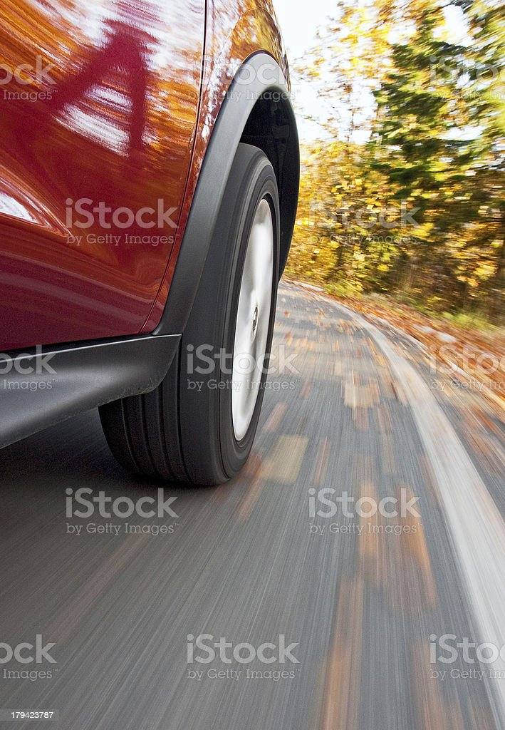 Driving a car in the autumn royalty-free stock photo