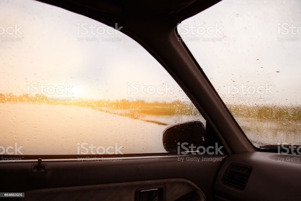 Driving a car in the rain stock photo