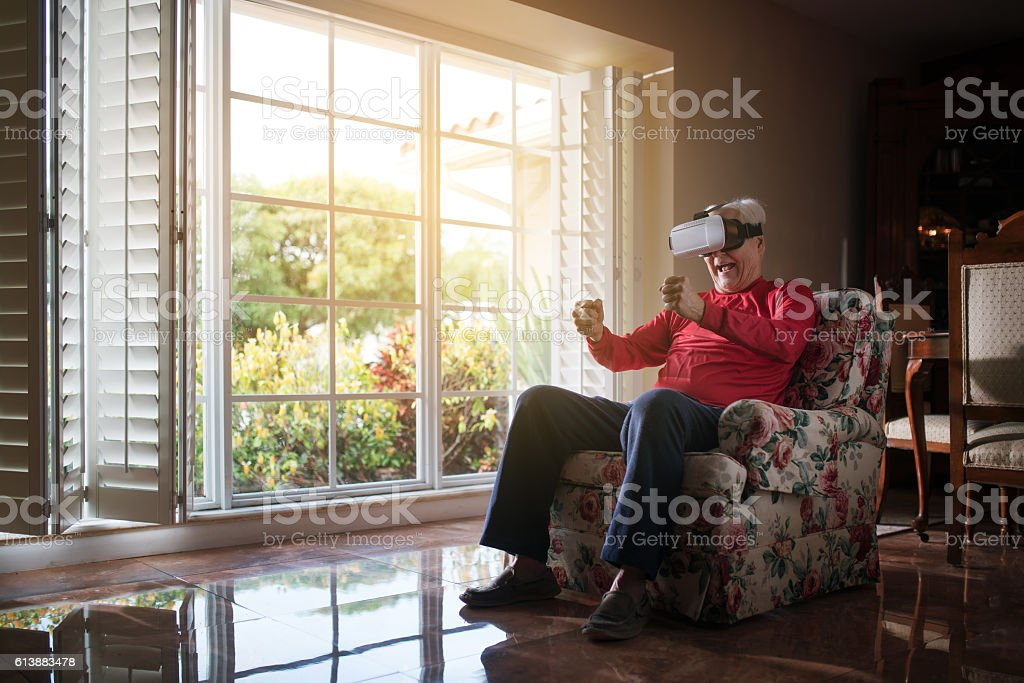 Driving a car inside my living room stock photo