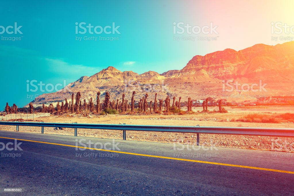 Driving a car on mountain road in desert. Israel stock photo