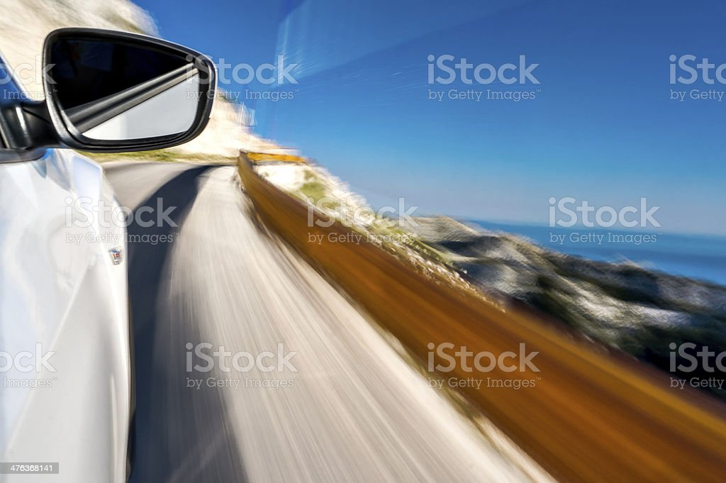 Driving a car uphill stock photo