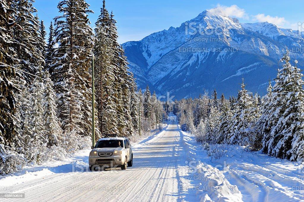 Driving a four-wheel car in Rocky Mountains near Golden, Canada stock photo