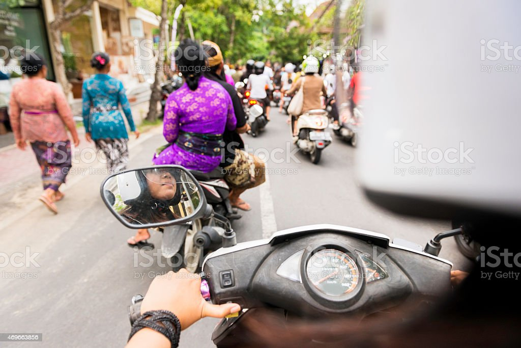 Driving a Motorbike Scooter Through Ubud Bali Rush Hour Indonesia stock photo