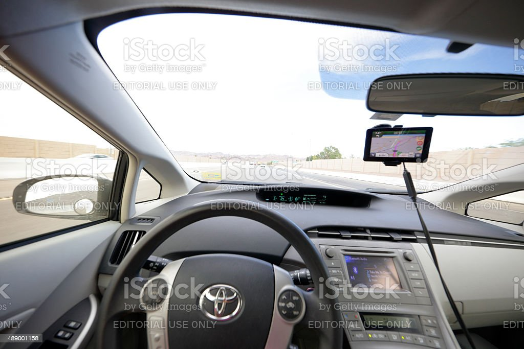Driving a Prius stock photo