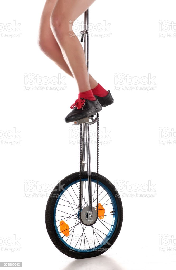 driving a unicycle on a white background stock photo