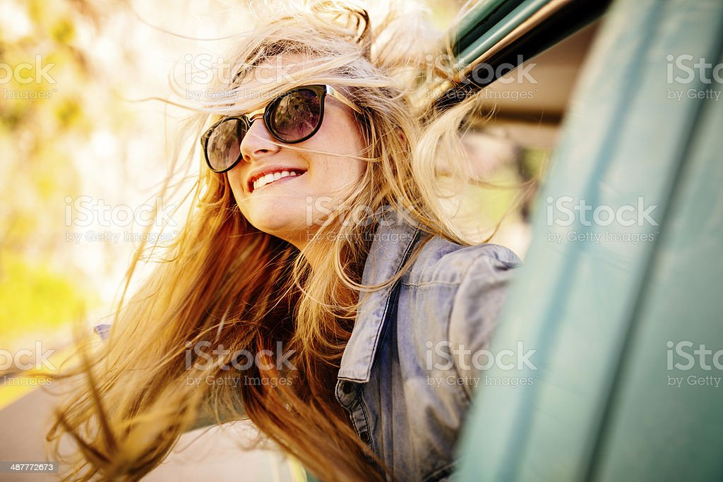 Driving and feeling the wind stock photo