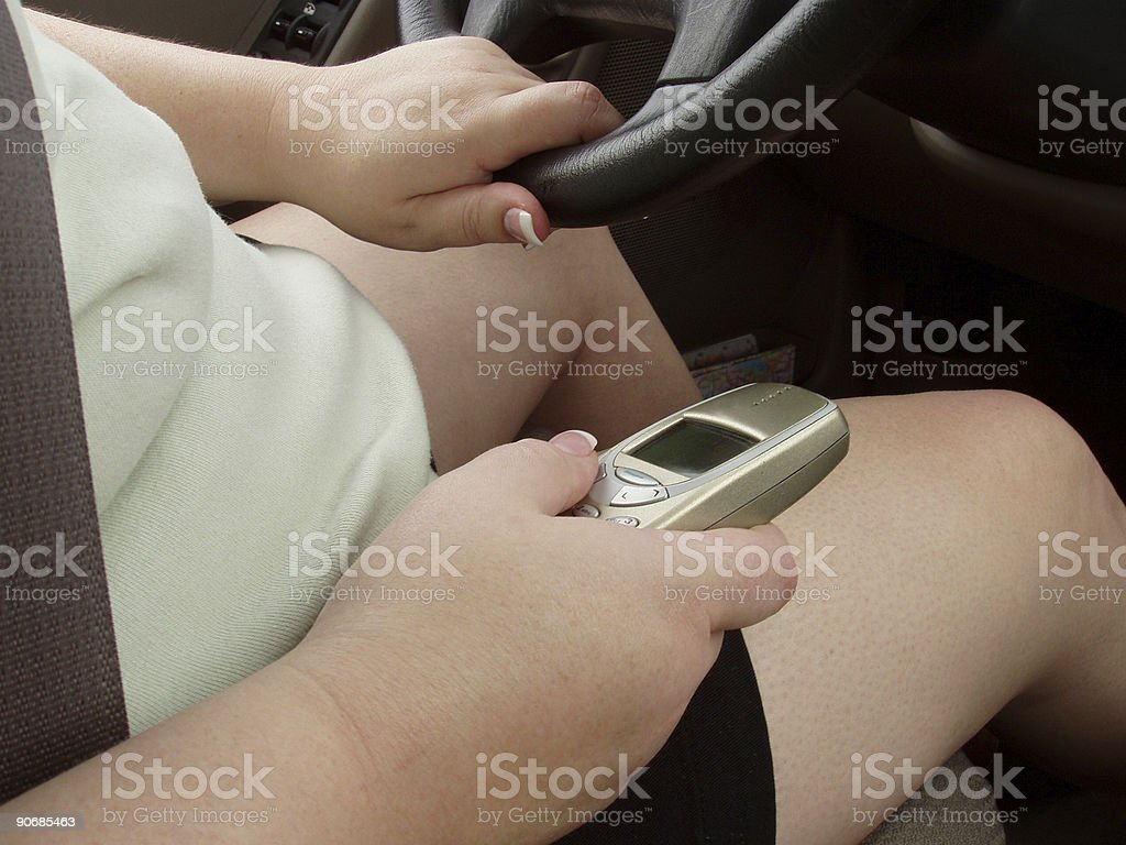 Driving and talking on cell phone stock photo