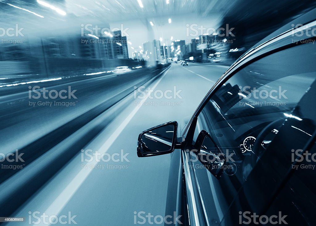 Driving at night stock photo
