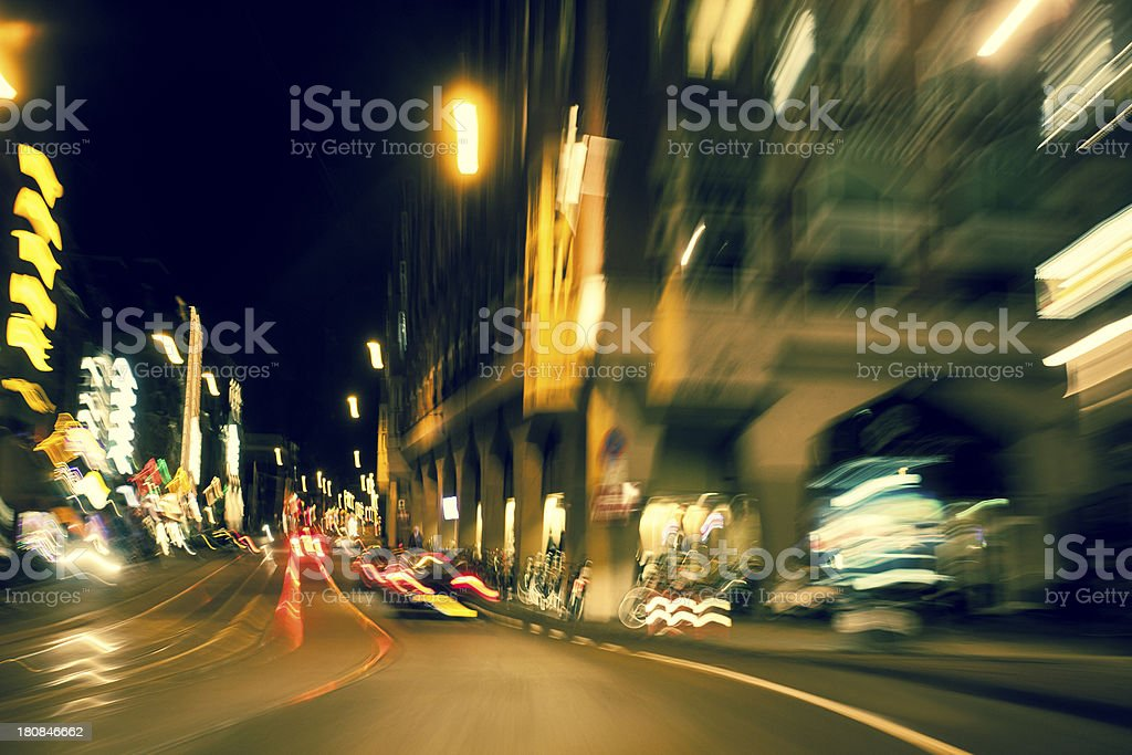 Driving at night with abstract city light trails royalty-free stock photo