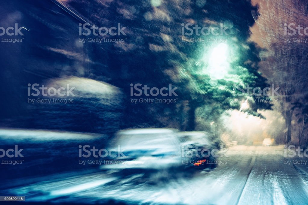 driving at snowfall stock photo