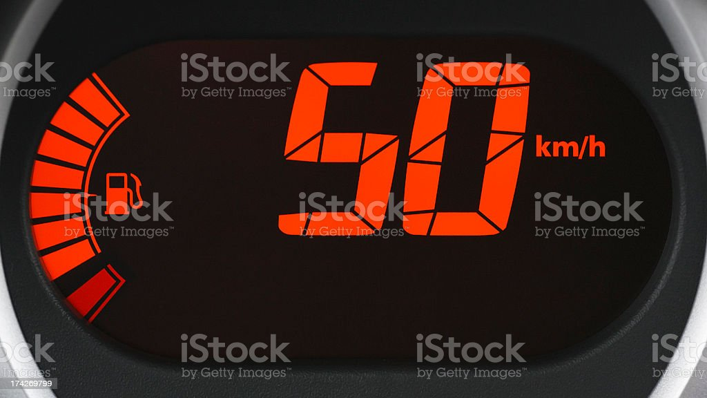 Driving at speed limit 50 km/h, close-up of digital dashboard stock photo