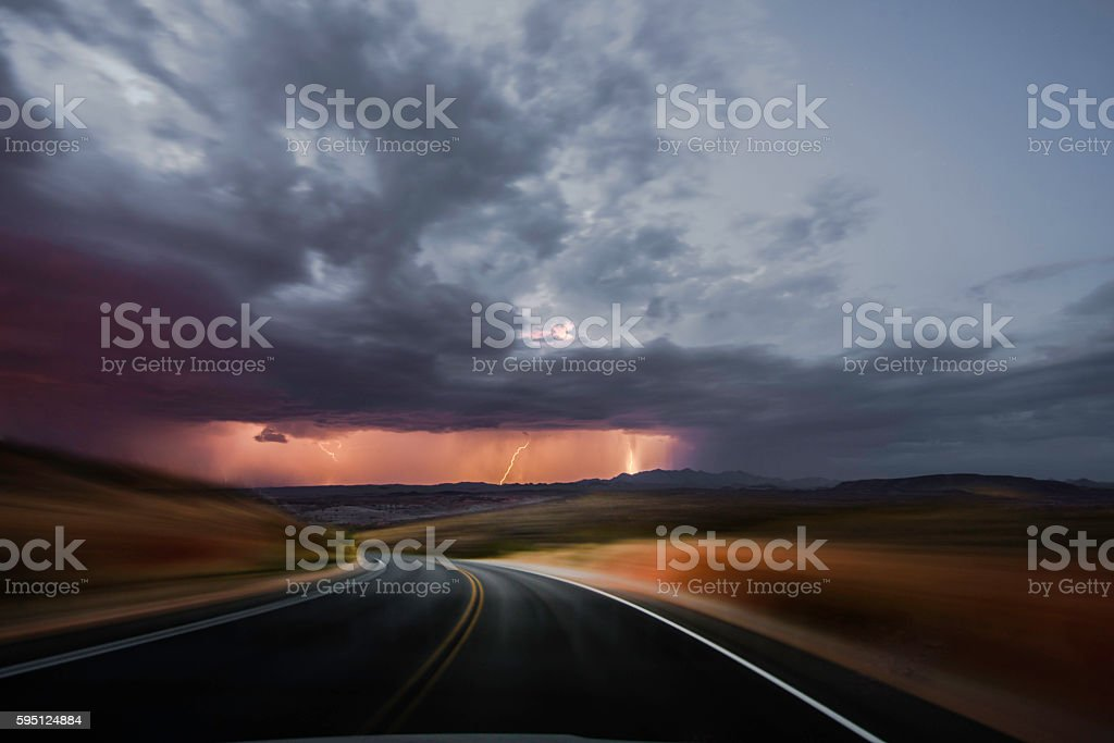Driving at sunset stock photo