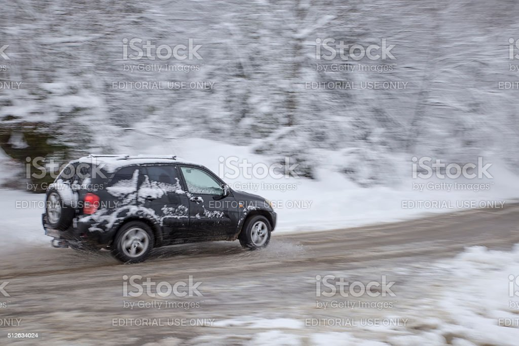 Driving at winter in snow stock photo