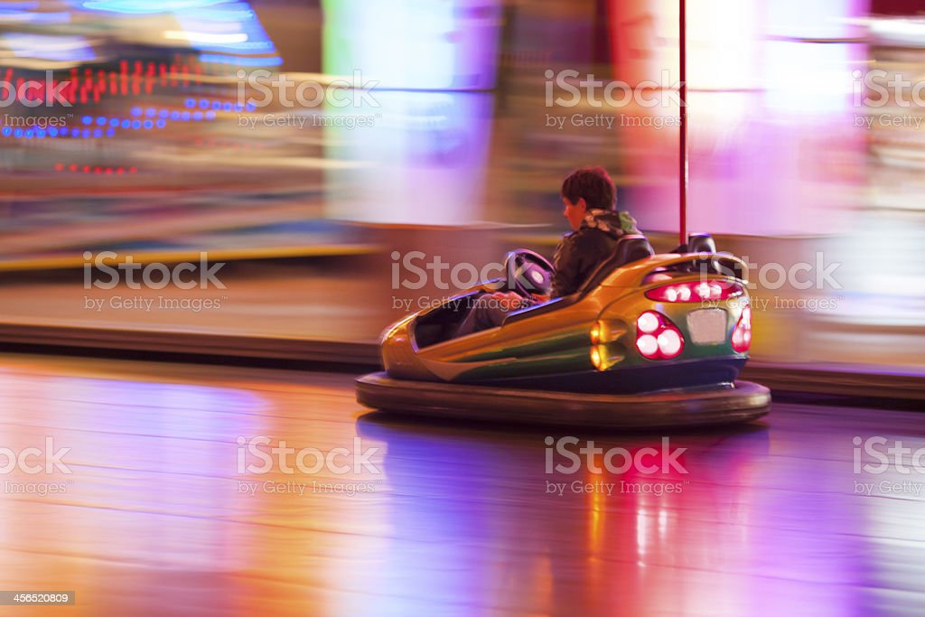 Driving bumper cars stock photo