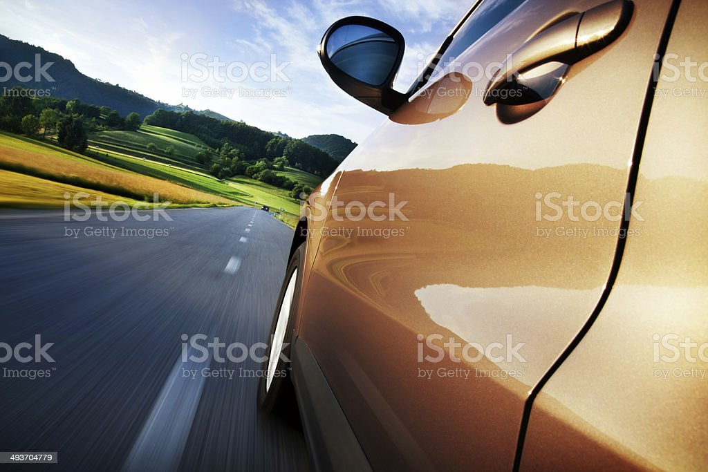 driving car at country road stock photo