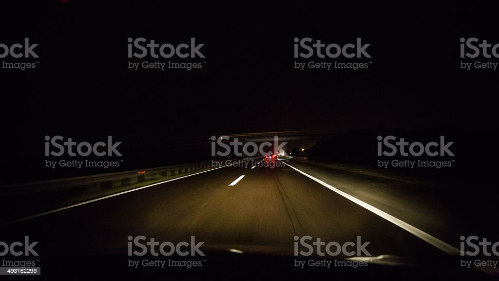 Driving car at night stock photo