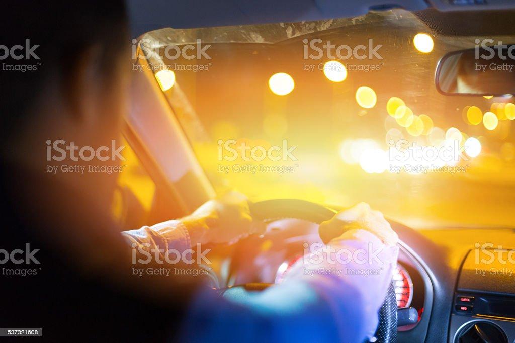 Driving car at night stock photo