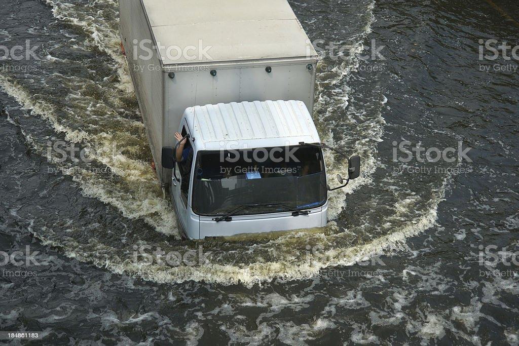 Driving Car in Flood Water at Bangkok, Thailand royalty-free stock photo
