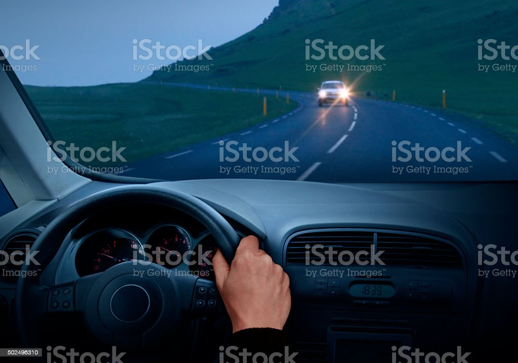 Driving car in the dusk stock photo