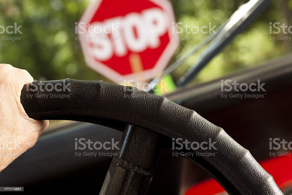 Driving car stopped at construction or school crossing stop sign. stock photo