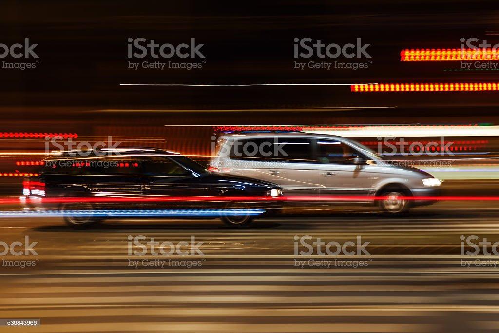 driving cars at night stock photo