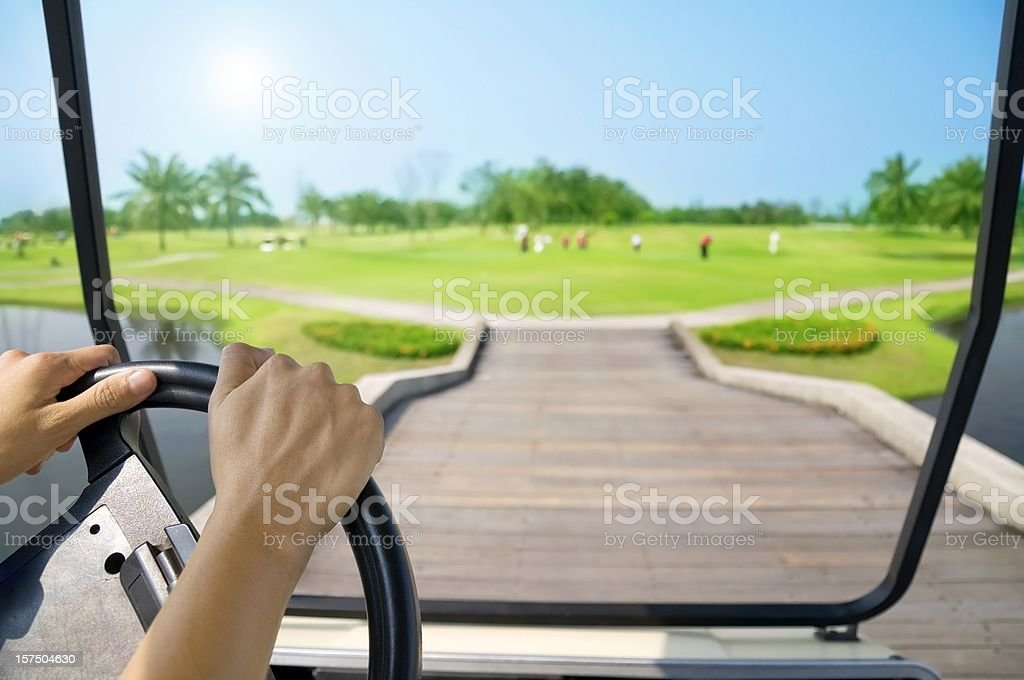 Driving cart at golf course in sunny day royalty-free stock photo