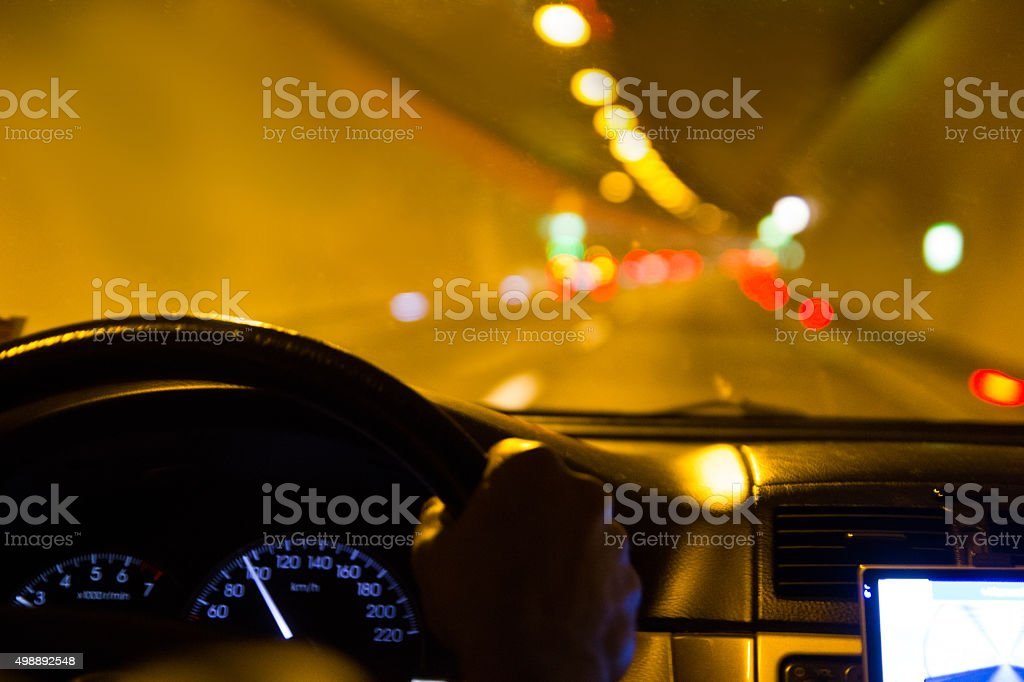 Driving detail, car steerwheel,  tunnel and curve stock photo