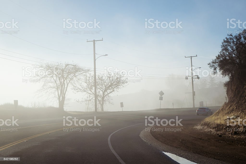 Driving down foggy highway in Malibu Creek State Park stock photo