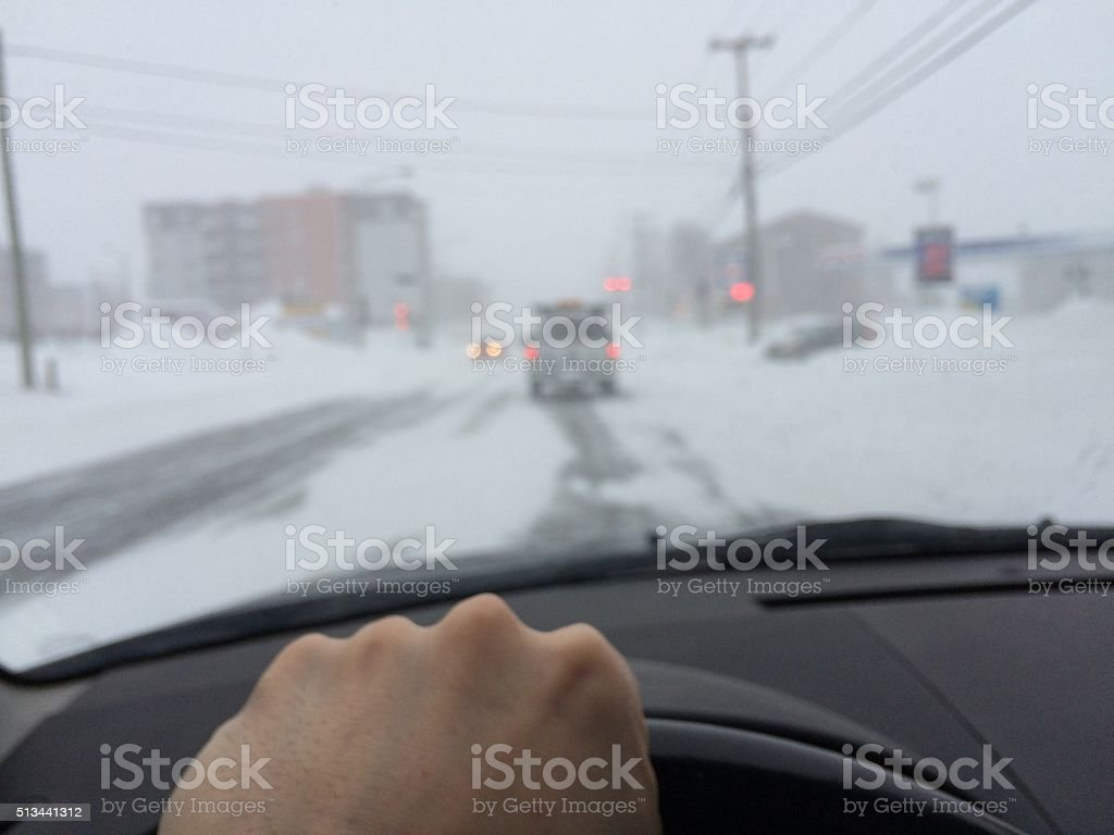 POV Driving during a snow storm stock photo